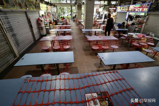 堂食禁令加上巴刹感染群使新加坡熟食中心冷冷清清